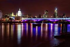 London night cityscape with Blackfriars Bridge and St Pauls Cath. London skyline with illuminated Blackfriars Bridge over the River Thames and The St Paul`s Stock Photos