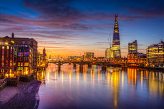 London Skyline  by night. River Thames in the twilight shot as hdr Royalty Free Stock Photo