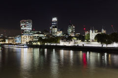 London Skyline at Night. The London Skyline at Night across the River Thames royalty free stock images