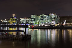 London Skyline at Night. The London Skyline at Night across the River Thames stock photos