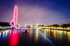 London skyline by night. London skyline at night with lights reflecting from the Thames River Stock Photos