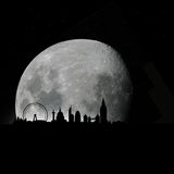 London skyline by night with moon. Vector illustration as silhouette of city of london by night with full moon in the sky, with all the most famous monuments and Stock Images