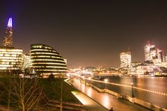 London Skyline at Night over the Chard and Thames River.  royalty free stock photography
