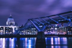 London skyline at night on River Thames with Millennium Bridge. Stunning view on the River Thames in London Royalty Free Stock Images