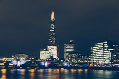 London skyline at night with shard building and reflections on R. London skyline at night with shard building lights and reflections on River Thames Stock Photo