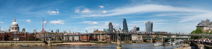 London skyline panorama with Millenium bridge seen from Thames Stock Photos