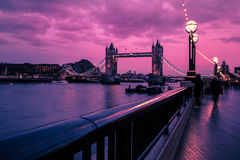 London skyline during pink sunset on River Thames. Iconic view of the London skyline at sunset stock image
