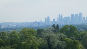 London Skyline rising from the forest The Shard and The O2 Arena royalty free stock photography