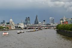 London skyline river Thames dark clouds royalty free stock photography