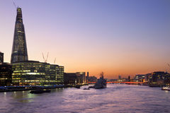 London Skyline - River Thames - Great Britain. The skyline of London at dusk looking to the southwest and across the River Thames towards The Shard, a new Stock Photo