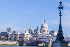 London skyline with Saint Paul`s cathedral. London skyline with old fashioned street lamp in foreground and Blackfriars bridge and Saint Paul`s cathedral in the Royalty Free Stock Images
