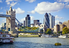 London skyline seen from the River Thames. Financial District of London and the Tower Bridge stock image