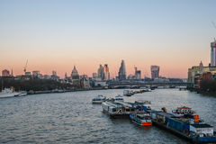 London skyline shot from Waterloo bridge at dusk. Royalty Free Stock Image
