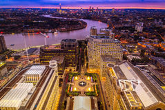 London skyline at sunset, aerial view with Canary Wharf Stock Images