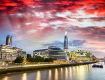 London skyline at sunset along Thames Stock Photography