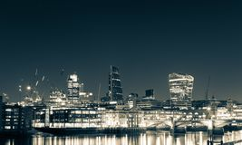 London skyline and Thames at night.  Stock Photography