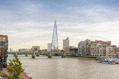 London skyline and Thames river on a cloudy day Stock Photography