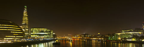 London skyline from Tower bridge. A skyline taken from Tower bridge to London bridge, where the recently built the shard is to the left and the southwark side royalty free stock images