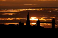 London skyline with Tower Bridge and Shard at sunset illustration. London skyline with Tower Bridge and Shard black silhouette at sunset illustration Royalty Free Stock Photo