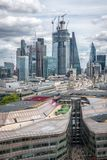 London skyline with a view of the financial district with the gherkin and microphone building. On a cloudy day royalty free stock photo
