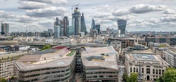 London skyline with a view of the financial district with the gherkin and microphone building. On a cloudy day stock photography