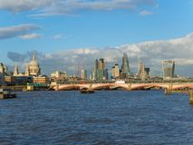 London skyline with a view of St Paul`s Cathedral, Blackfriars Bridge and skyscrapers of the City on a sunny afternoon. London skyline with a view of the River Royalty Free Stock Photography