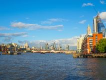 London skyline with a view of St Paul`s Cathedral, Blackfriars Bridge and skyscrapers of the City on a sunny afternoon. London skyline with a view of the River Royalty Free Stock Photos