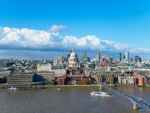 London skyline with St Paul`s Cathedral, Millennium Bridge and skyscrapers of the north bank of the River Thames. Royalty Free Stock Photo