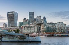 London skyscrapers in City of London at sunset time. And HMS Belfast Stock Images