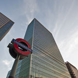 London skyscrapers and the underground sign Stock Photos