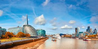 London, South Bank Of The Thames on a bright day in Autumn. Panoramic image taken from the Tower bridge royalty free stock photos