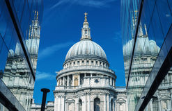 London. St Paul Cathedral reflected in modern glass on a beautif Stock Images
