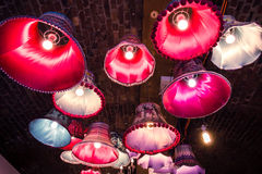 London The Stable market lamp light shades in red purple pink co Stock Photography