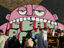 London stads- gata Art Graffiti Figure på en vägg Royaltyfria Bilder