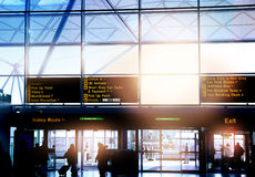 LONDON STANSTED AIRPORT, UK - MARCH 23, 2014: Airport window and information board Stock Photo