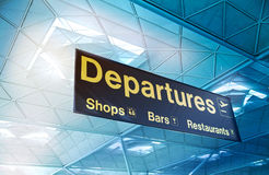 LONDON STANSTED AIRPORT, UK - MARCH 23, 2014: yellow departure sign at a international airport Royalty Free Stock Images