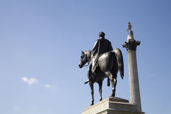 London  - statue of George IV and Nelson column Royalty Free Stock Photos