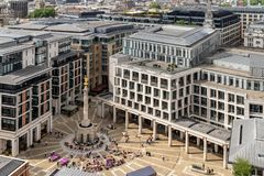 London stock exchange. Building at Paternoster Square next to St Paul`s Cathedral in the City of London, England stock photos