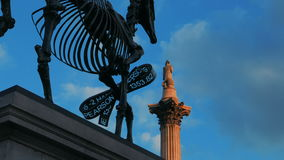 London Stock Exchange Ticker in Trafalgar Square Against White Clouds. A timelapse view of the London Stock Exchange Ticker attached to the Gift Horse statue in stock video footage