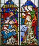 LONDON STORBRITANNIEN - SEPTEMBER 14, 2017: Kristi födelsen av Jesus Christ på målat glass i kyrkaSten Michael Cornhill Fotografering för Bildbyråer
