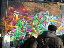 London Street Art in a busy Street Market. Royalty Free Stock Image