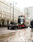 London Street Black Taxi And Red Bus On The Raining Day In London. Shallow Depth of Field royalty free stock photography