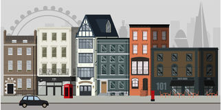 London street. Street landscape with apartment buildings, shops and bars and London skyline in the background royalty free illustration