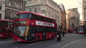 London street, red bus stooping .mp4