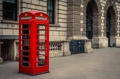 London street. Red London phone booth on street Stock Photo