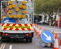 London street roadworks scene with Highway Maintenance car and K. London street barricaded with Highway Maintenance vehicle and traffic cones with Keep Right Stock Photo