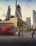 London street scene, England. London street scene with iconic red double decker bus commuting workers employees into the City Financial area Royalty Free Stock Photography