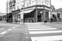 London, street scenes Bow, pedestrian crossing to deli across in. Grey London street scene black and white Bow intersection with pedestrian crossing to Royalty Free Stock Images