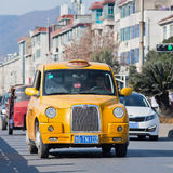 London style yellow cab in Hengdian city, China Royalty Free Stock Photos