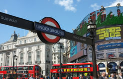 London Subway sign and Street Life Stock Photography